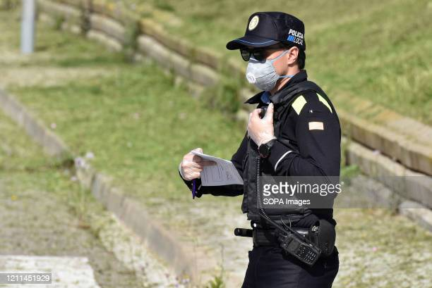 A police officer wearing a face mask at a checkpoint as a preventive measure during the Coronavirus lockdown crisis The Vendrell Local Police...