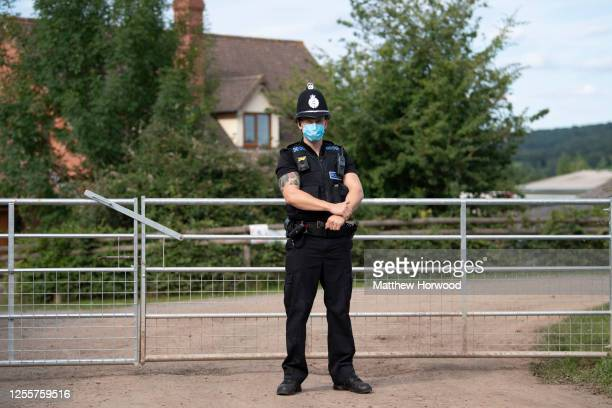 A police officer wearing a surgical face mask stands at the entrance to AS Green and Co farm on July 12 2020 in Mathon Herefordshire AS Green and Co...