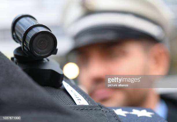 A police officer wearing a video camera on his shoulder in front of a police station in Frankfurt/Main Germany 18 November 2016 After one year of...
