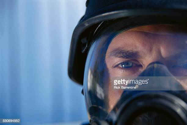 Police Officer Wearing Gas Mask