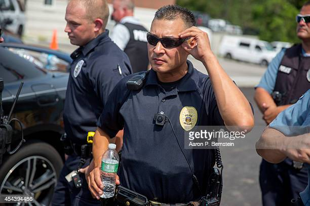 A police officer wears a body camera at a rally for Michael Brown August 30 2014 in Ferguson Missouri Michael Brown an 18yearold unarmed teenager was...
