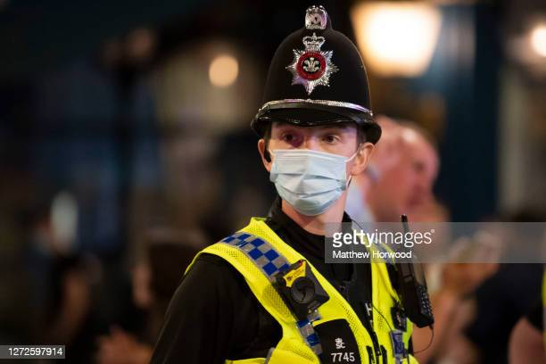Police officer wears a face mask on St. Mary Street on September 12, 2020 in Cardiff, Wales. Lockdown rules have been tightened in Wales in an effort...