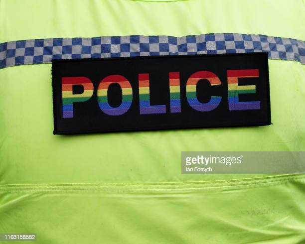 Police officer wears a pride coloured police badge on his uniform as thousands of people take to the streets as they take part in the Newcastle Pride...