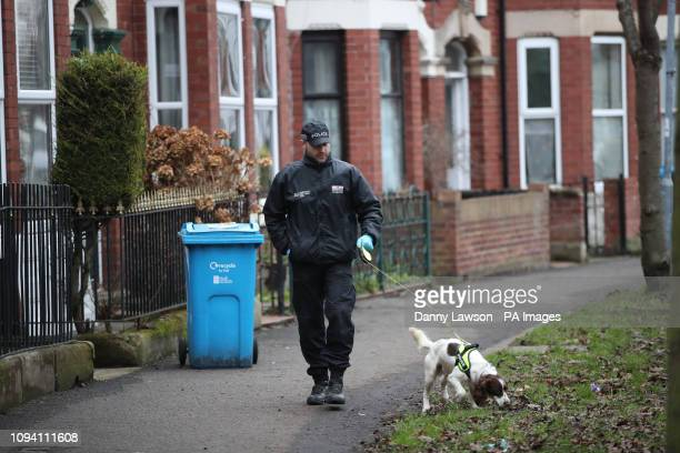 A police officer with a dog conducts a search on Wellesley Avenue in Hull as they investigate the disappearance of 21yearold student Libby Squire who...