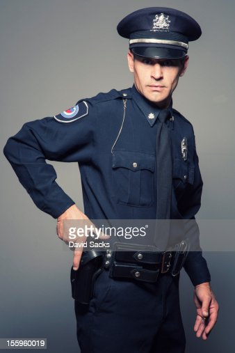 In Out Board >> Police Officer With Gun High-Res Stock Photo - Getty Images