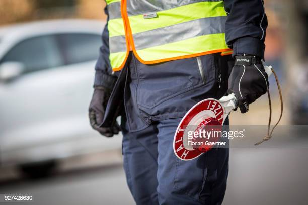 A police officer with police trowel during a traffic control in Berlin on February 27 2018 in Berlin Germany