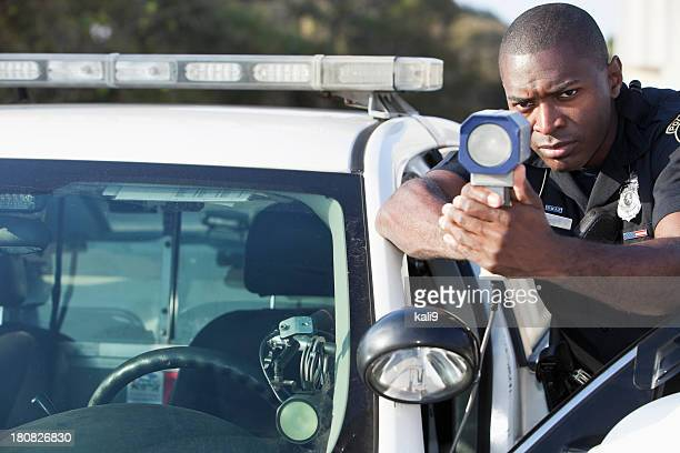 police officer with radar gun - traffic cop stock pictures, royalty-free photos & images