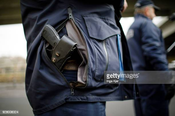 A police officer with service weapon on February 27 2018 in Berlin Germany