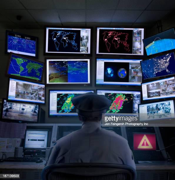 police officer working in control room - bewaken stockfoto's en -beelden