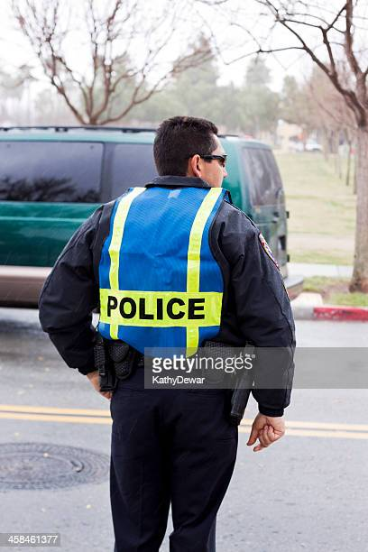 police officer working in the rain - kathy shower stock pictures, royalty-free photos & images