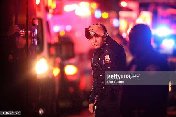 A police officer works the scene of a shooting that left multiple people dead on December 10 2019 in Jersey City New Jersey In a raging gun battle...