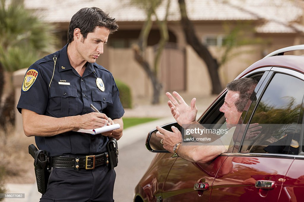 Police Officer Writing Ticket : Stock Photo