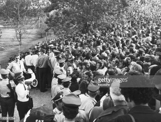 Police officers address the crowds at the Munich Olympics following the kidnap and murder of eleven members of the Israeli team by Palestinian...