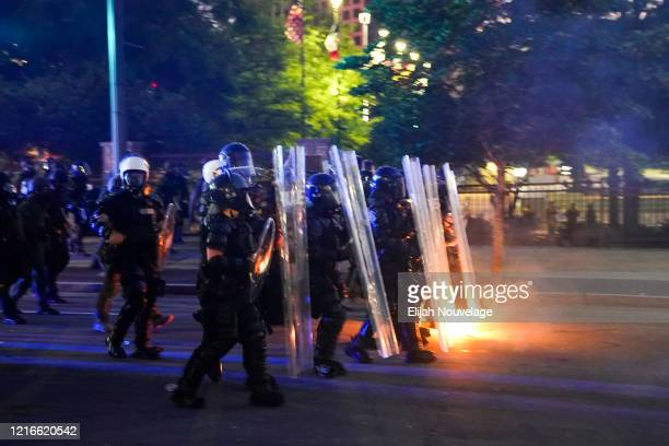 Police officers advance after firing tear gas during a demonstration on May 31 2020 in Atlanta Georgia Across the country protests have erupted...