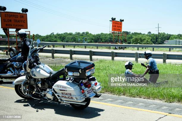 Police officers aids an officer involved in an accident while escorting a motorcade with US President Donald Trump from Chennault International...