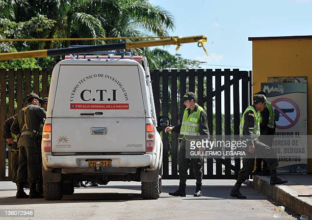 Police officers and a vehicle of the Technical Research of the National Prosecutor of Colombia are seen outside the Las Malocas recreational park, on...