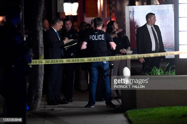 Police officers and agents stand outside an office building were multiple people were killed in a shooting in Orange, California on March 31, 2021. -...