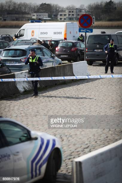 Police officers and and SedeeDovo the mine clearance service of Belgian defence patrol in Antwerp where Belgian police arrested a man on March 23...