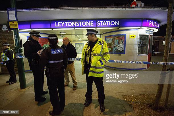 Police officers and crime scene investigators investigate a crime scene at Leytonstone tube station in east London England on December 05 2015 after...