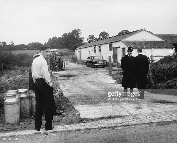 Police officers and detectives at the entrance to Leatherslade Farm in Buckinghamshire the hideout for The Great Train Robbers 14th August 1963