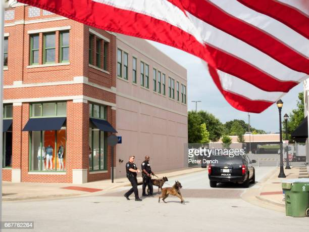Police officers and dogs from the nearby Dallas Fort Worth airport search the town of Southlake for explosives ahead of the annual Stars Stripes...