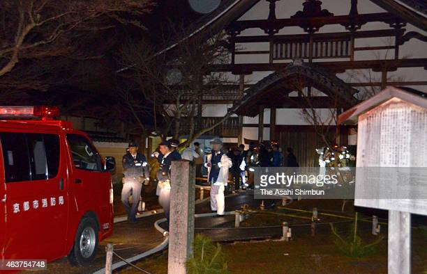 Police officers and fire brigade members are seen at Kodaiji temple on February 17 2015 in Kyoto Japan A nighttime fire destroyed a building on the...