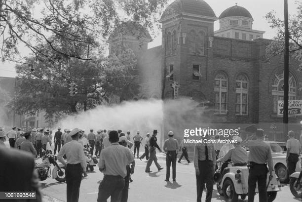 Police officers and fire fighters are called to quell unrest at the 16th Street Baptist Church headquarters of the Birmingham Campaign in Birmingham...