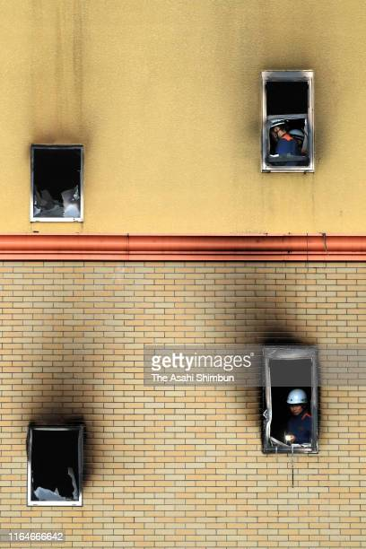Police officers and fire fighters investigate the burnt Kyoto Animation Studio building on July 19 2019 in Kyoto Japan 33 people were killed by the...