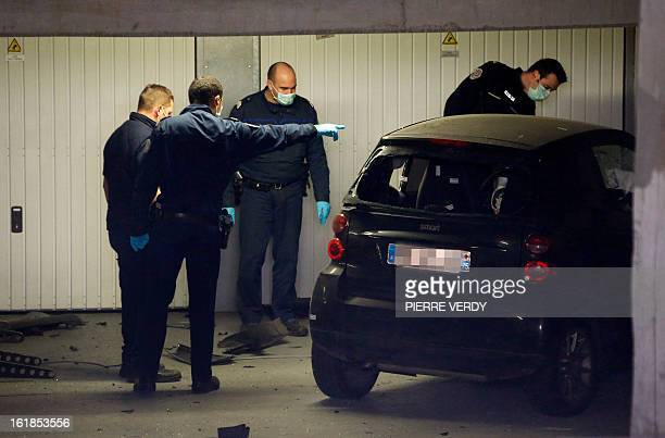 Police officers and forensic experts search for evidence around a car on February 17, 2013 in Montrouge, a southern Paris suburb, after a 20-year old...