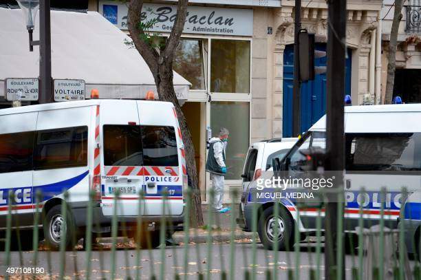 Police officers and forensic scientists inspect an area near to the Bataclan theatre in Paris on November 14 following a series of terrorist attacks...