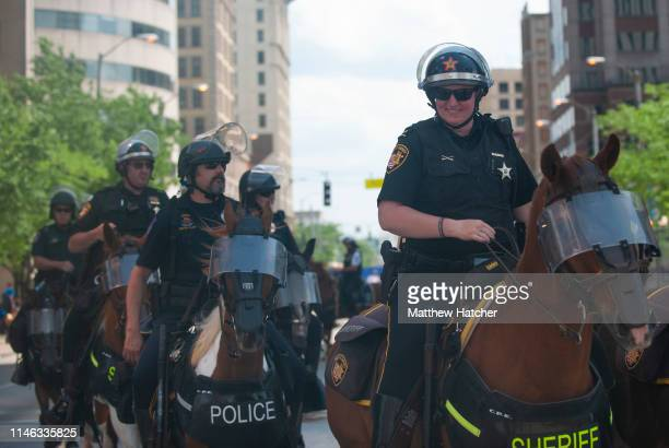 Police officers and Highway State patrol officers keep careful watch over the various activities occurring during a rally held by the KKK affiliated...