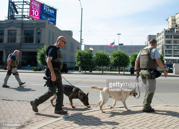 Police officers and Highway State Patrol officers prepare to respond to a rally held by the KKK affiliated group Honorable Sacred Knights of Indiana...
