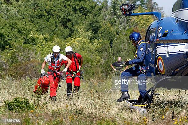 Police officers and members of a fire brigade speak before participating on June 28 2011 in RoquebrunesurArgens in a massive search for murder...