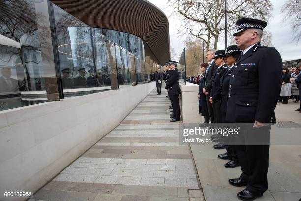 Police officers and members of the Metropolitan Police's senior management observe a minute's silence outside New Scotland Yard during a vigil to...