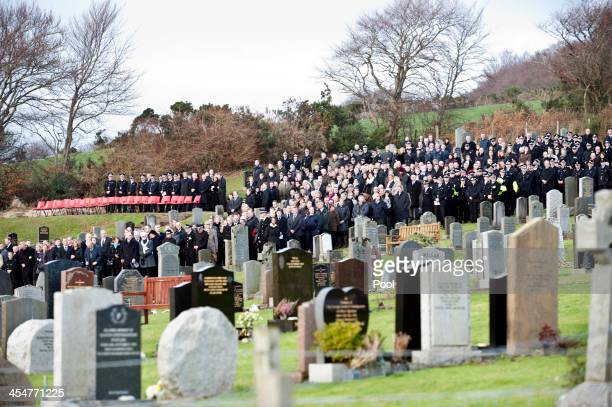 Police officers and members of the public attend the funeral of Clutha Vaults victim Constable Tony Collins at Lamlash cemetery on December 10 2013...