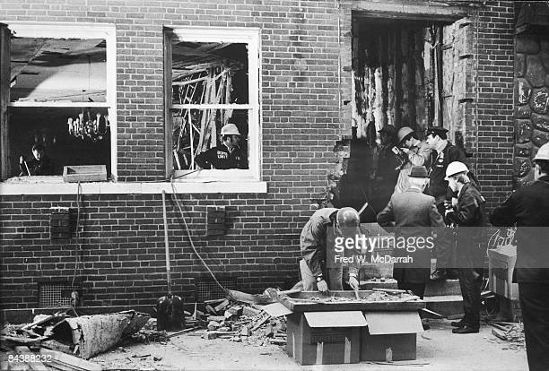 Police officers and menbers of the bomb unit look for evidence amid the wreckage from an explosion in the basement of 18 West 11th Street New York...