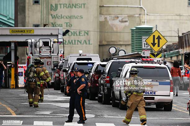 Police officers and NJ firefighters arrive to the train terminal after a New Jersey Transit train crashed into the platform at Hoboken Terminal...
