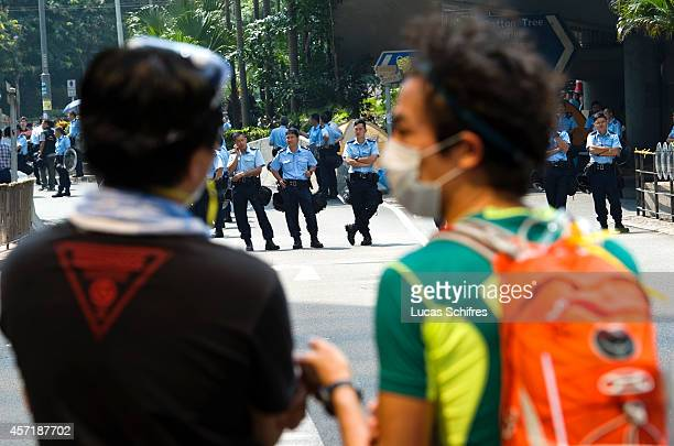 Police officers and pro-democracy 'Occupy Central' protesters have reached a face-off at a barricade set by protesters on Cotton Tree Drive, in...