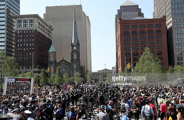 Police officers and protesters fill Cleveland Public Square during a demonstration near the site of the Republican National Convention on July 19...