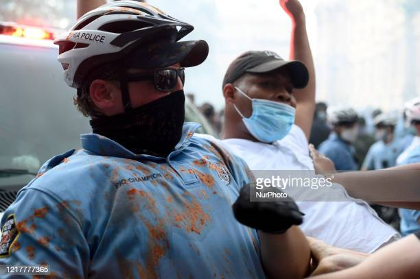Police officers and protestors clash in Center City Philadelphia PA on may 30 2020 The police unite responding falls under supervisor on Staff...
