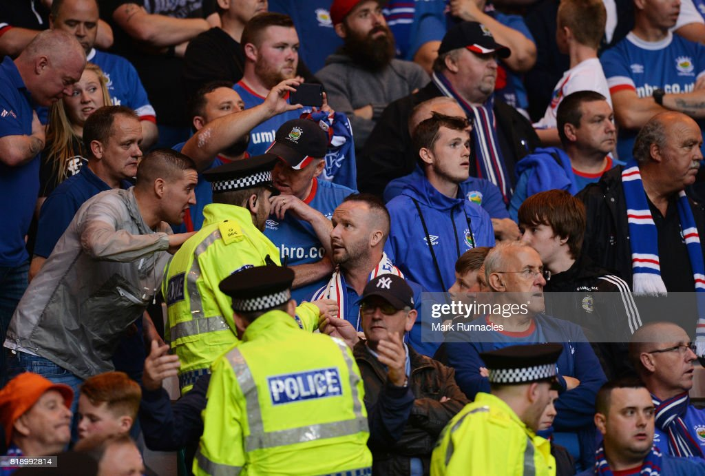 Police officers and stewards go into the Linfield supports section as tempers flare during the UEFA Champions League Qualifying Second Round, Second Leg match between Celtic and Linfield at Celtic Park Stadium on July 19, 2017 in Glasgow, Scotland.