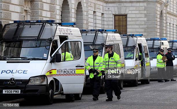 Police officers and vehicles are stationed in Westminster in anticipation of student protests on December 13 2010 in London England Protesters are...