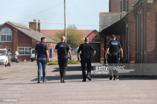 Police officers appear to inspect the new asylum seeker temporary accommodation at Napier Barracks on September 21, 2020 in Folkestone, England. It...