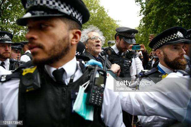 Police officers apprehend Piers Corbyn Jeremy Corbyn's brother during a demonstration against the coronavirus lockdown in Hyde Park on May 16 2020 in...