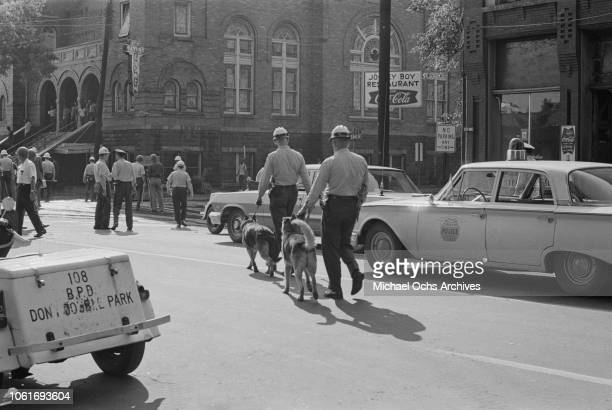 Police officers are called to the 16th Street Baptist Church, headquarters of the Birmingham Campaign in Birmingham, Alabama, May 1963. The movement,...