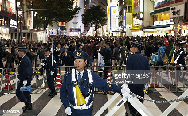 Police officers are deployed in Tokyo's Shibuya commercial district on Oct 31 ahead of Halloween celebrations