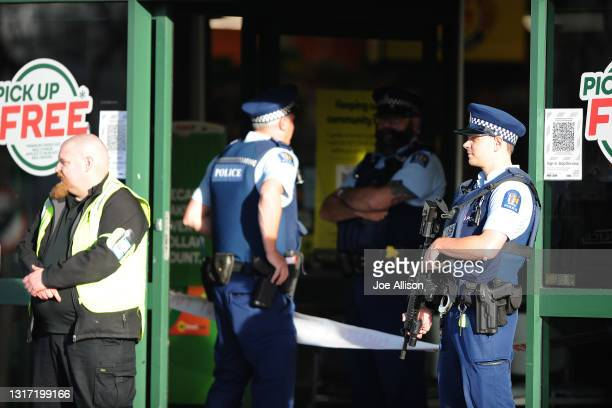 Police officers are observed standing guard outside the main entrance of the Dunedin Central Countdown on May 10, 2021 in Dunedin, New Zealand. Four...