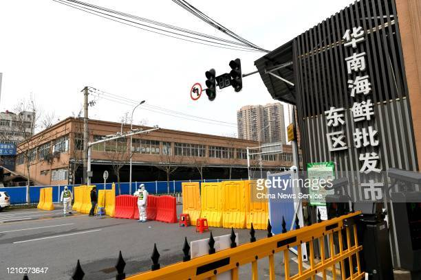 Police officers are on duty during disinfection work at Huanan Wholesale Seafood Market on March 4 2020 in Wuhan Hubei Province of China Disinfection...