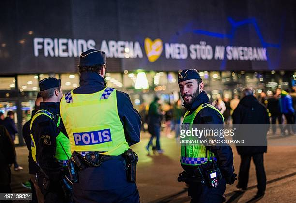 Police officers are pictured ahead of the Euro 2016 playoff football match between Sweden and Denmark at the Friends arena in Solna on November 14...