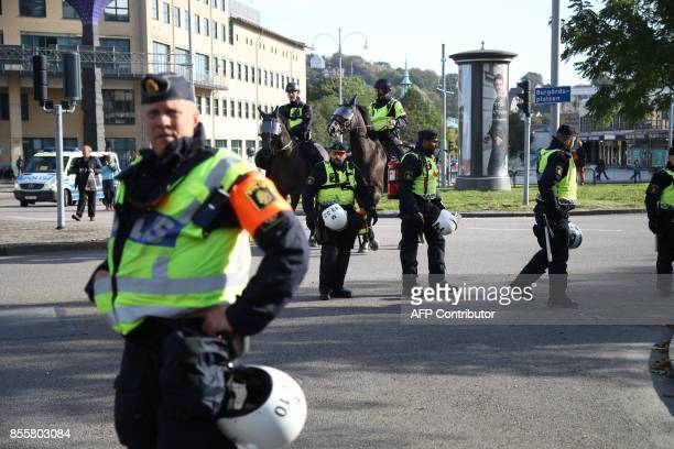 Police officers are pictured prior to the farright Nordic Resistance Movement march in Gothenburg Sweden on September 30 2017 News Agency / Adam IHSE...